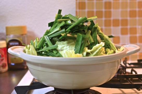 高く野菜をつむ